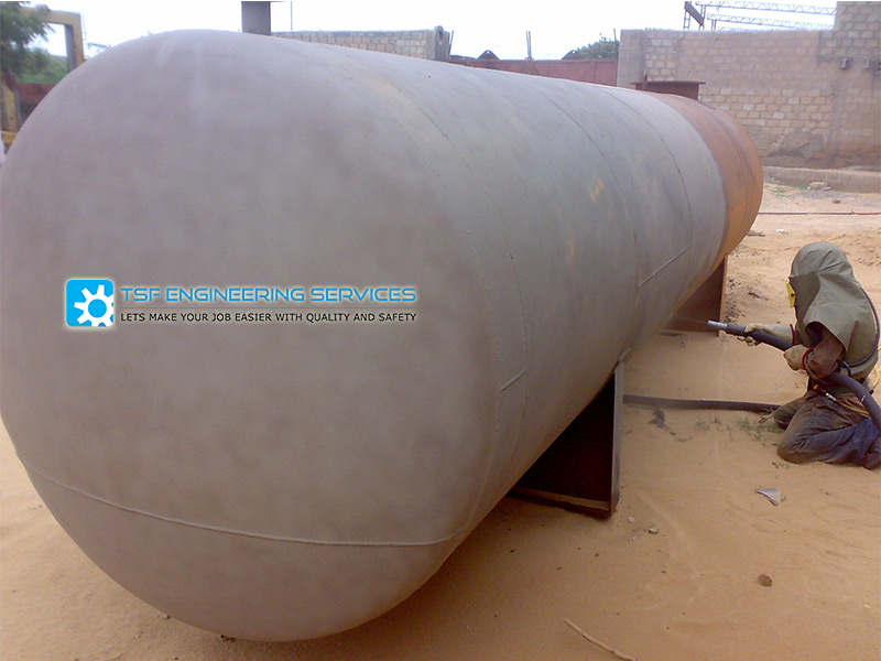 sand blasting on underground oil tank